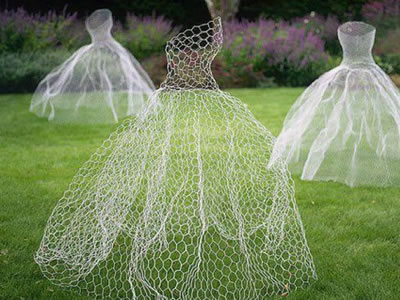 There are three ghost dresses made of chicken wire.