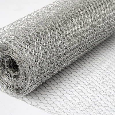 A roll of galvanized hexagonal wire mesh on the white background.