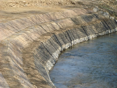 Green terramesh is used on the circum of a pond in a three level form.